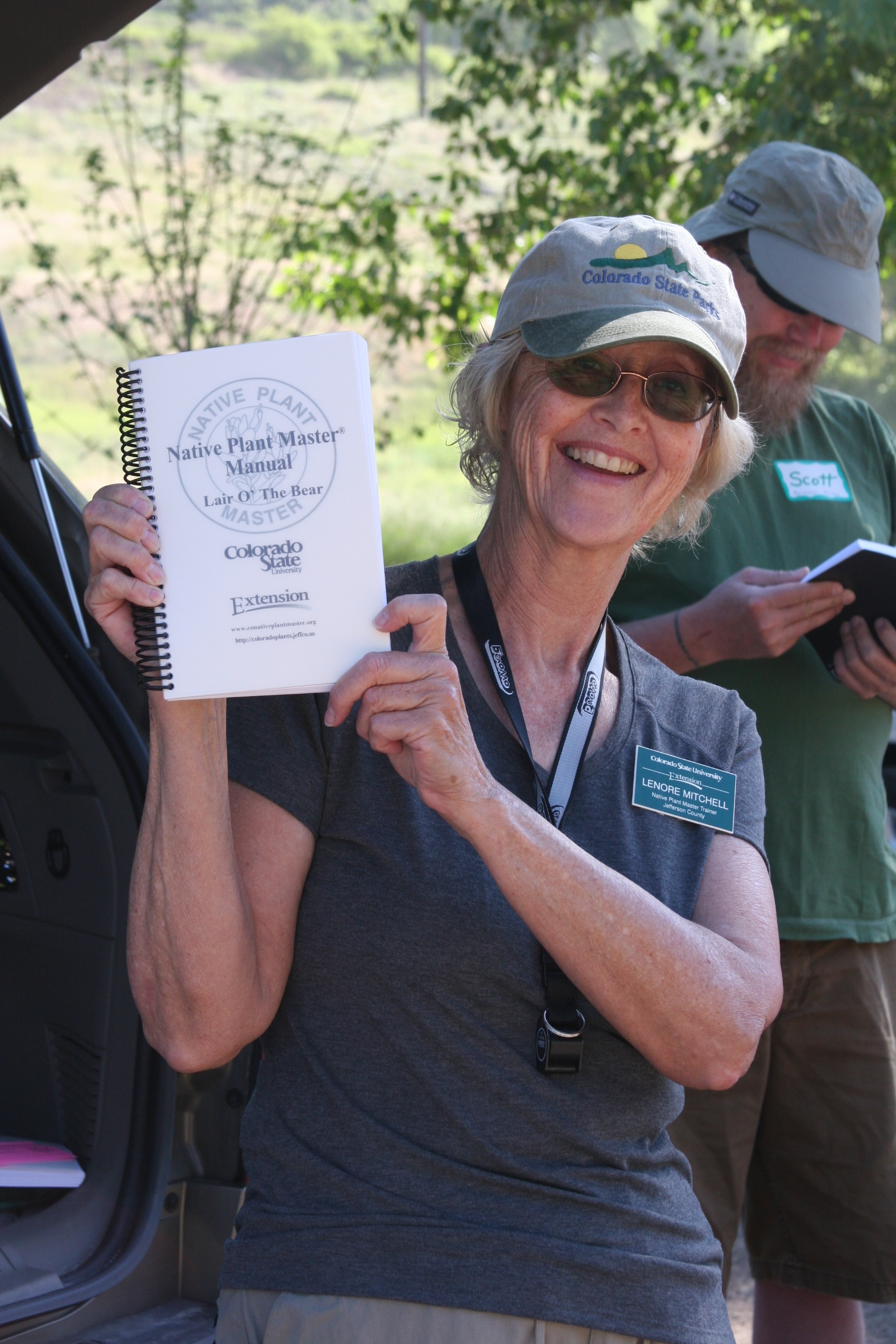 NPM Trainer holding Native Plant Master Manual