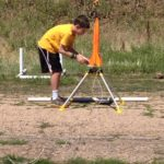 4-H member sets up his rocket on rocket launch day