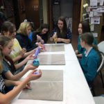 4-H girls practicing with icing for their cake decoration projects
