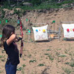 A member participating in the archery contest