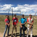 Four 4-H members take a group photo before the shotgun contest