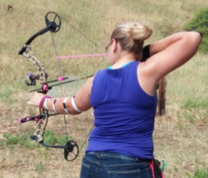 4-H member shooting archery